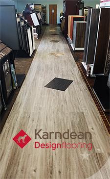 walkway featuring Karndean loose lay plank luxury vinyl plank flooring